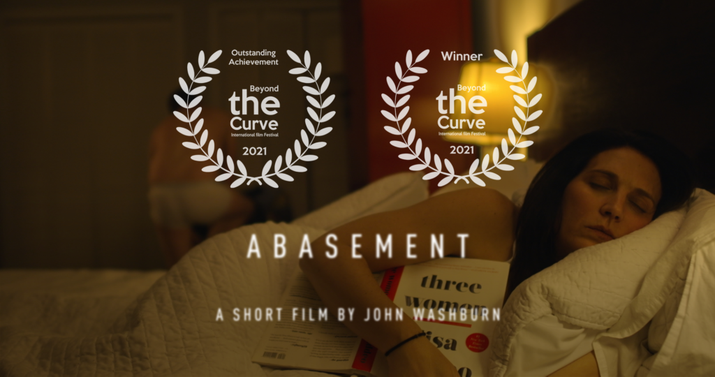 """Abasement poster with laurels for """"outstanding achievement"""" and """"winner"""" best horror"""